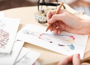 Logo Coloriste Infographiste - spécialité habillement mode textile